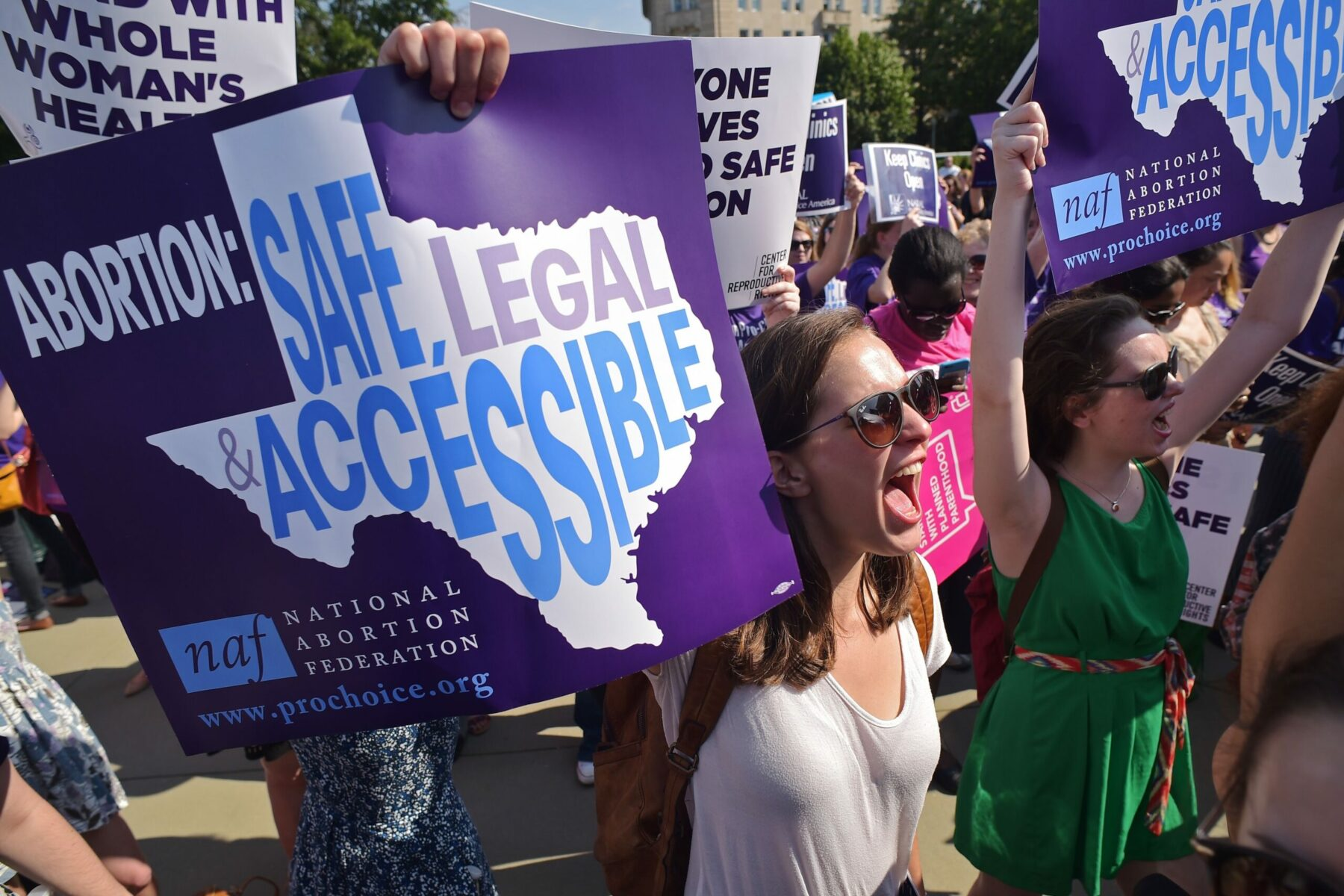 Abortion rights activists hold placards and chant outside of the US Supreme Court.
