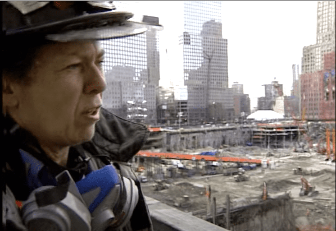 A woman firefighter standing at ground zero.