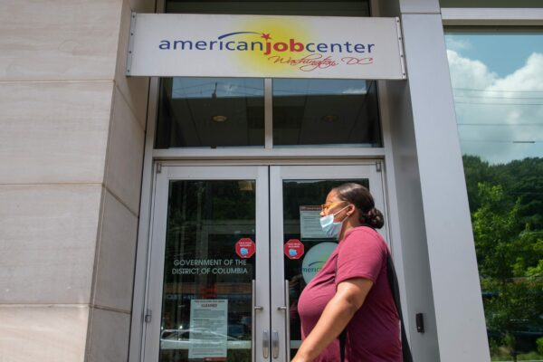 A woman walks past the the DC Department of Employment Services American Job Center.
