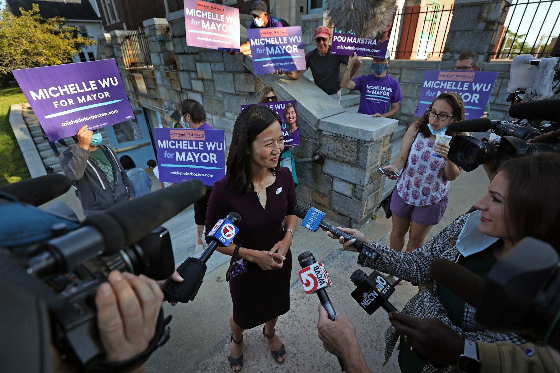 Michelle Wu speaks to the media