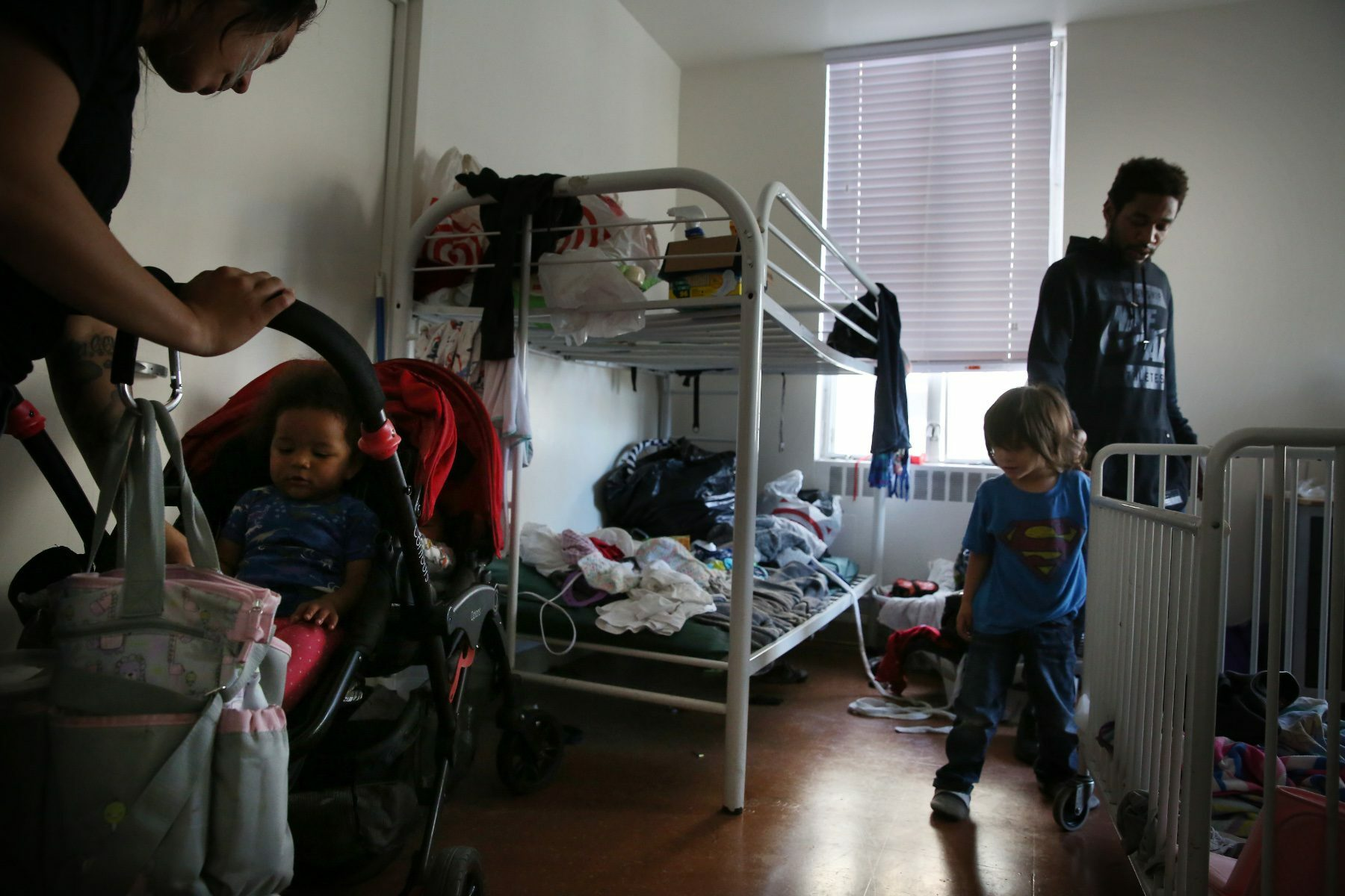 Photo of children and parents in a shelter.