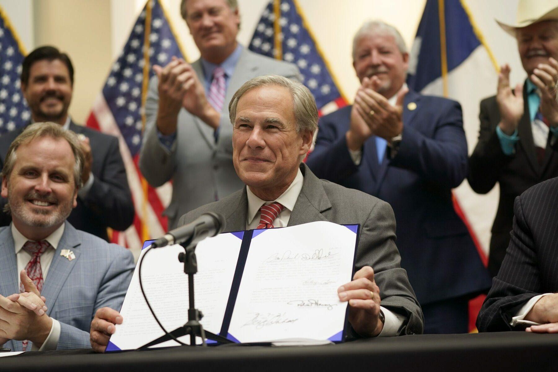 Texas Gov. Greg Abbott signs a bill
