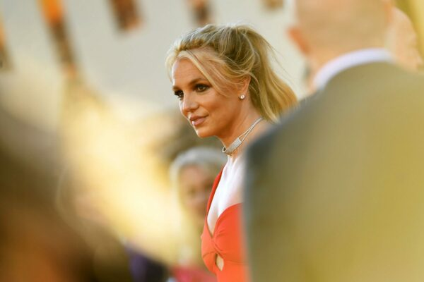 Britney Spears is seen wearing a red dress at a movie premiere.