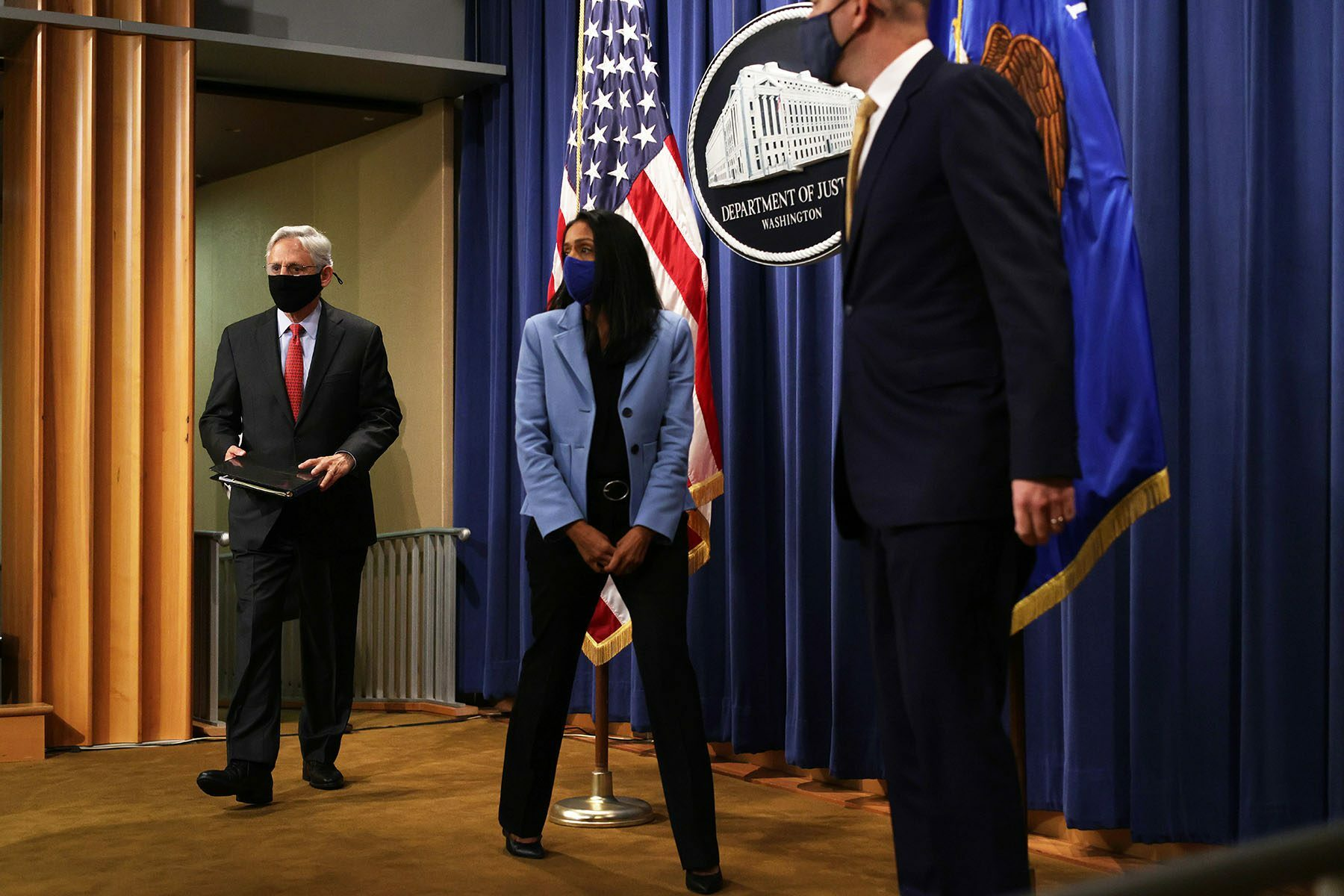 U.S. Attorney General Merrick Garland arrives at a news conference to announce a civil enforcement action at the Department of Justice.