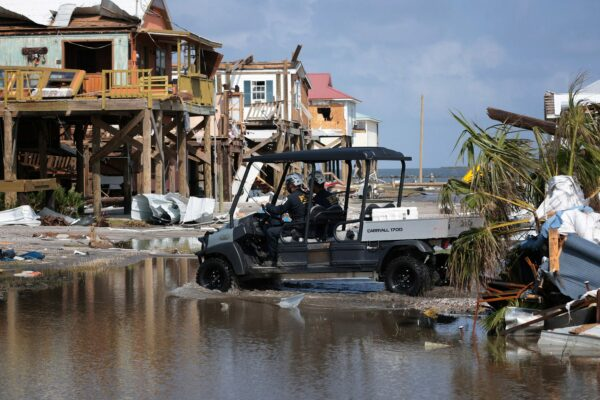 a search and rescue team in flooded Grand Isle, Louisiana