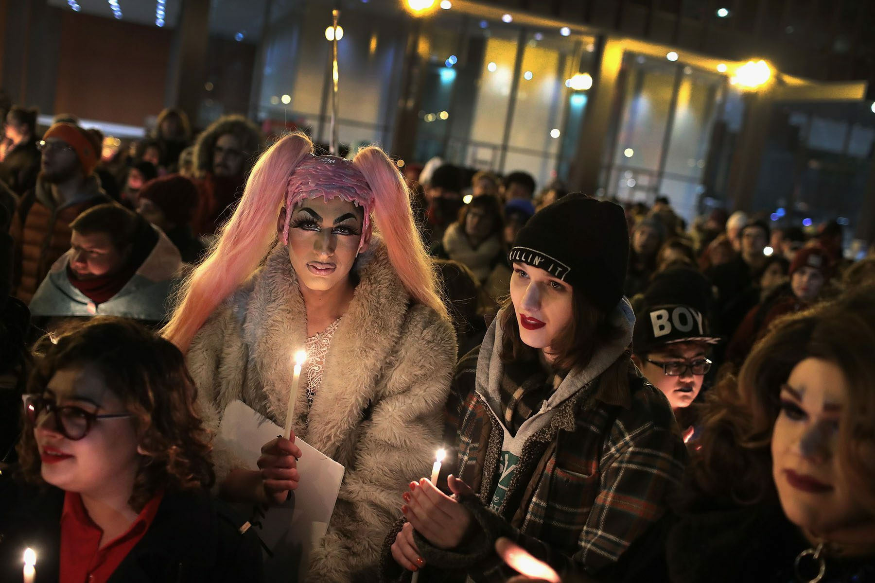 Activists hold candles during a vigil in remembrance of transgender friends lost to murder and suicide.