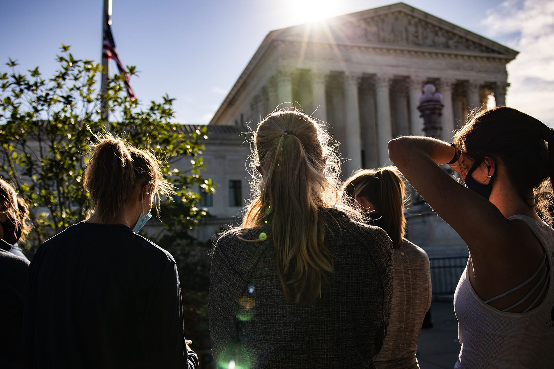 Women are seen gathering in front of the U.S. Supreme Court.