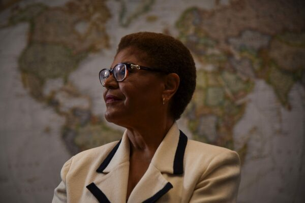 Karen Bass poses for a portrait in front of a wold map.
