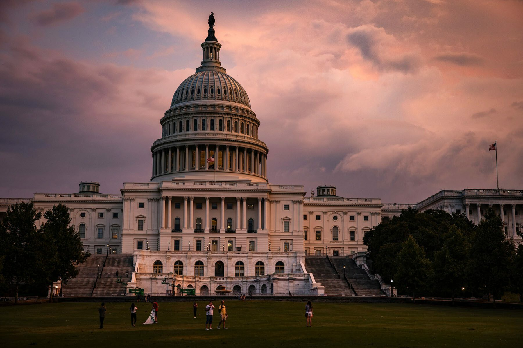 The U.S. Capitol Building is seen as the sun sets and large clouds from a thunderstorm run through the area.
