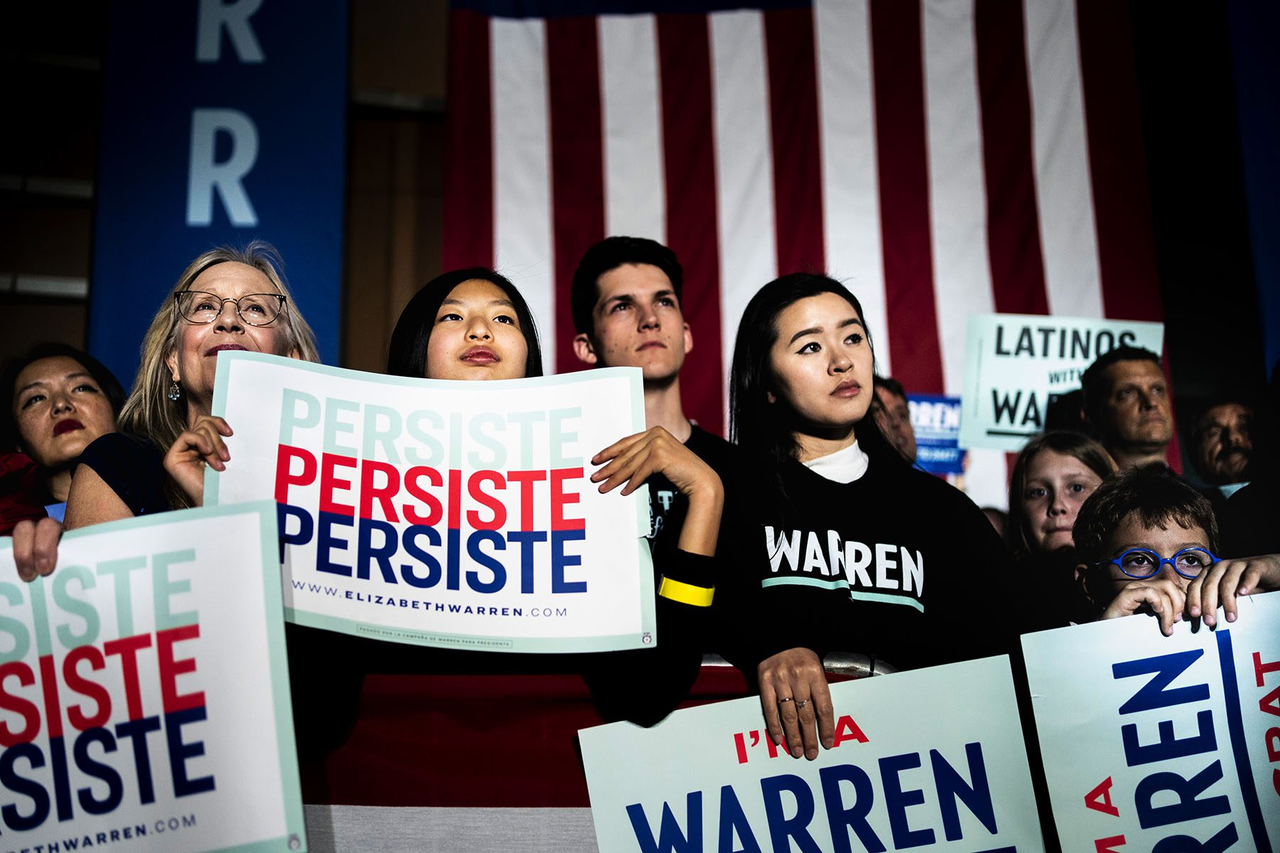 Warren supporters holding signs that say