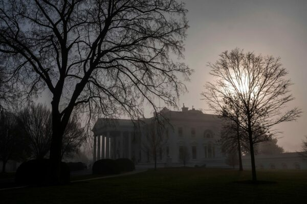 Fog surrounds the White House in the early hours of the morning.